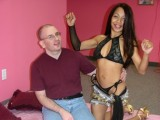 A sexy belly dancer gives him a big hard-on